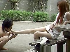 Japanese foot slave on Street