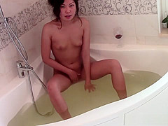 Playful young Chinese babe fingers her pussy