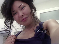 Slim arousing Chinese girl gets naughty in kitchen