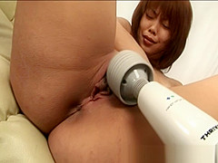 Asian babe Shows Off Her Shaved Pussy