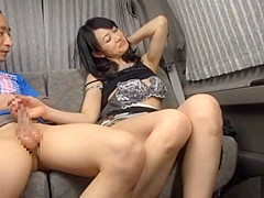 awesome black dressed Japanese woman is giving blowjob