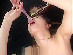 Japanese slut sucks condom dry