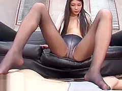 Hot Japanese footjob in black pantyhose