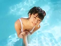 Sexy asian girl wearing heels in the pool.