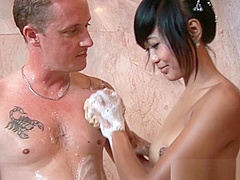 Asian girl giving a big cock a hot soapy massage